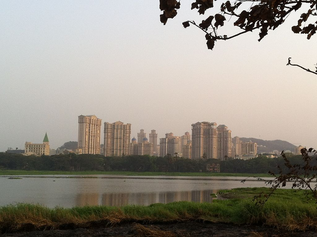 Lake Powai in teh foreground looking onto highrise buildings of IITB and city in the background